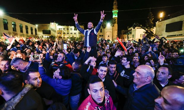 Palestinians celebrate Yaqoub Shaheen's victory in Bethlehem on Saturday night. Photograph: Ahmad Gharabli/AFP/Getty Images